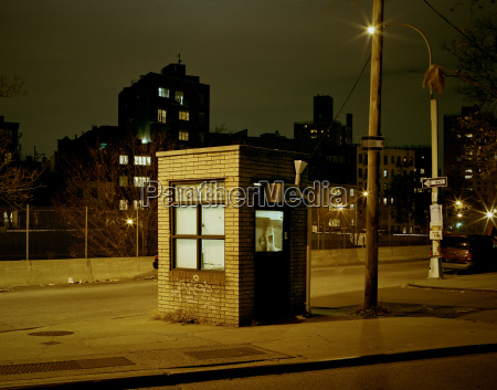 police booth at night in bushwick