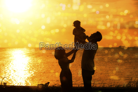 silhouette of family in outdoor beach