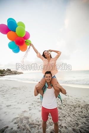 man giving piggyback to woman