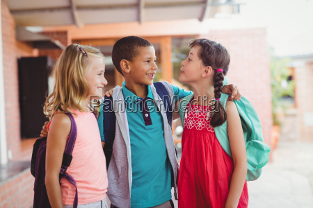 three kids with arms around each