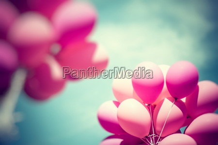 pink balloons and blue sky background