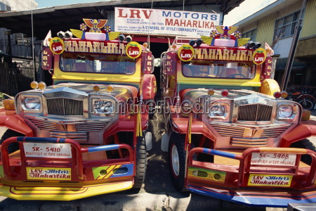 pair of customised jeepney trucks the