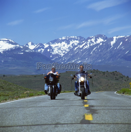 harley davidson bikers with snow capped