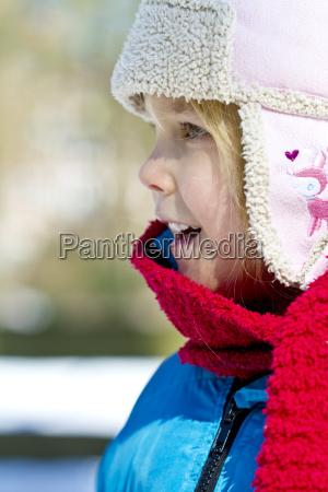 portrait of little girl wearing winter