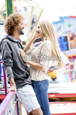 happy couple at a funfair