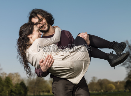 young woman in the arms of