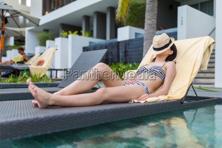 young woman enjoy sun bath in