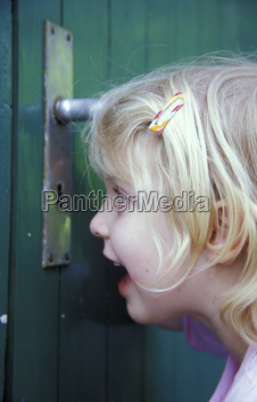 girl peeking close up