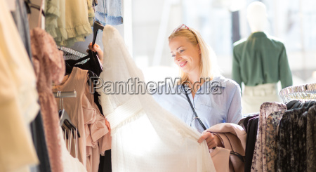 beautiful woman shopping fashionable clothes in