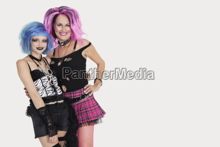 portrait of punk females standing with