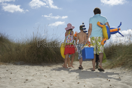 rear view of family with beach