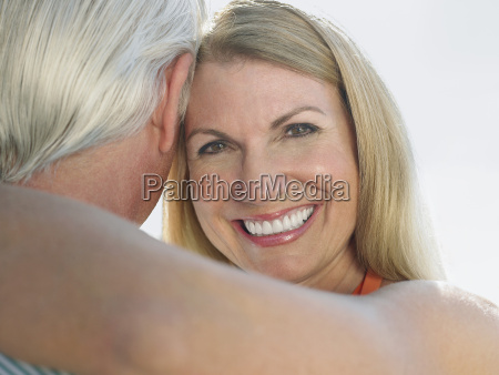 loving middle aged couple embracing