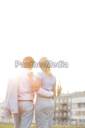 rear view of business couple standing