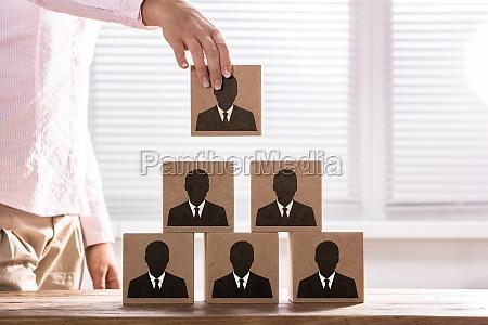 businesswoman making a business team pyramid