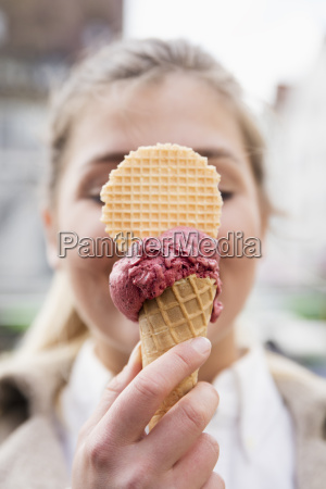 womans hand holding ice cream cone