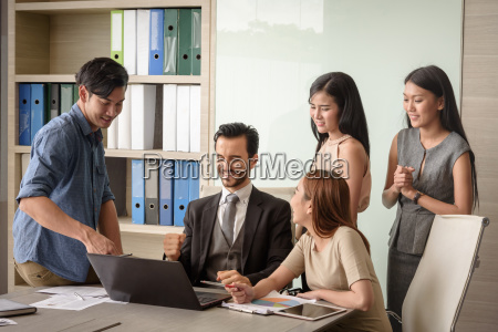young businesspeople man and woman using