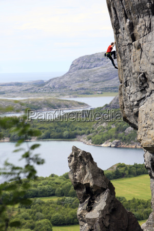 a climber scales a difficult route