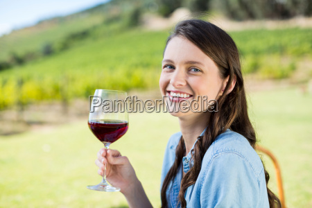 portrait of smiling woman holding red