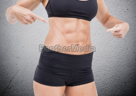 mid section of fit woman pointing