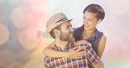 happy man giving piggyback ride to