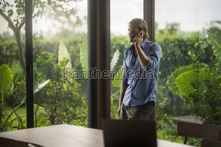 handsome man talking on smartphone in