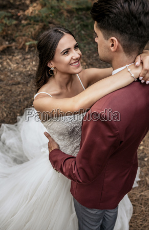 portrait of beautiful bride embracing and