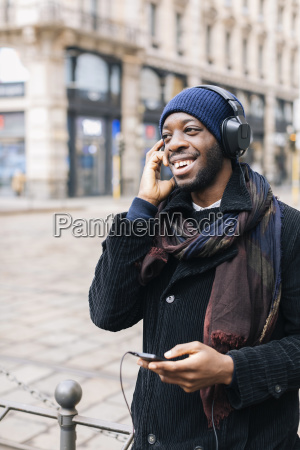 african american man with smartphone and
