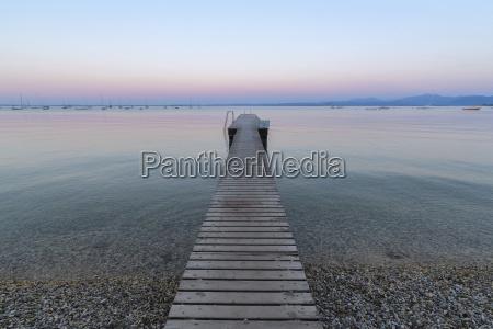 wooden jetty on lake gardo lago