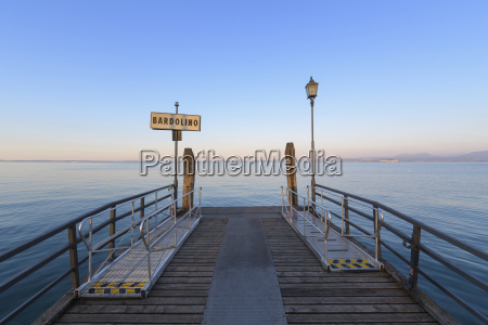 wooden pier on the lake garda