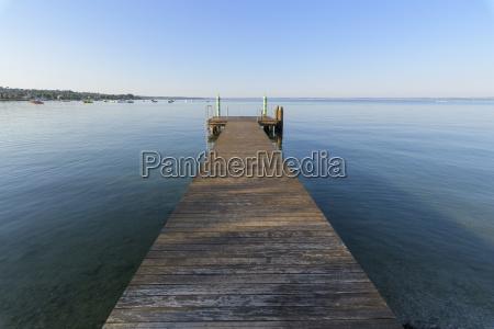 wooden jetty on lake garda lago
