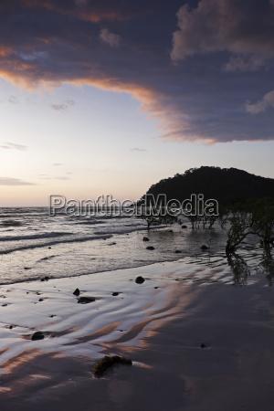 silhouette of coastal shoreline and beach