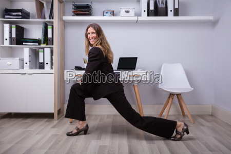 businesswoman doing stretching exercise