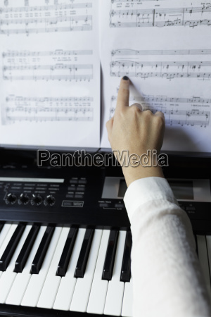 cropped hand of woman touching musical