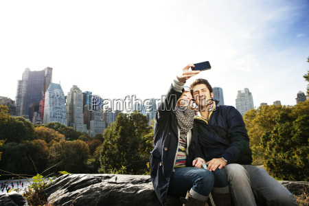 happy couple taking selfie in central