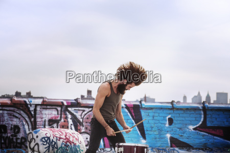 hipster playing drum on terries against