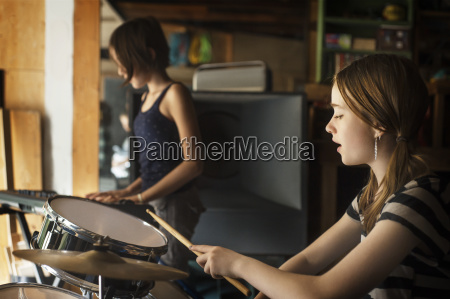 friends playing drum and piano in