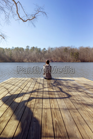 rear view of teenage girl sitting