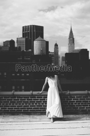 woman standing on building terrace against