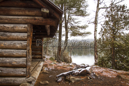 old log cabin by lake and