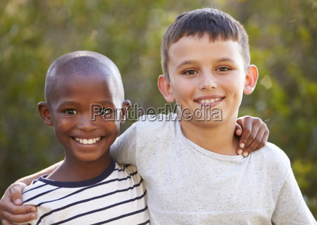 two boys arms around each other