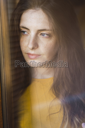 portrait of pensive young woman with