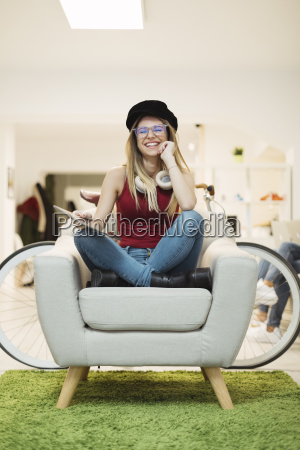 happy casual young woman with tablet