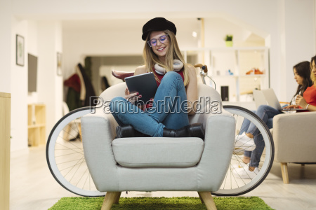 casual young woman using tablet in
