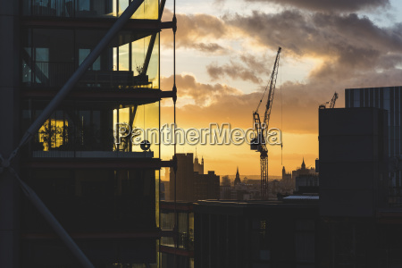 uk london buildings and crane silhouette