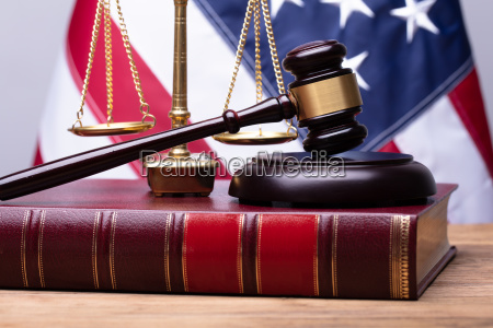 law book with mallet and justice