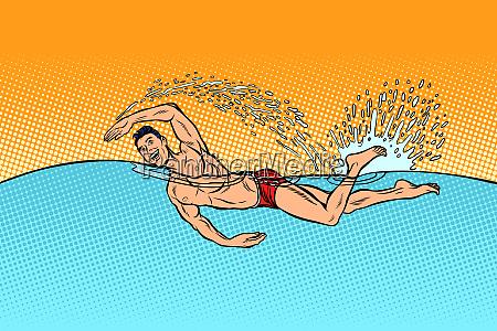 man swimmer swims