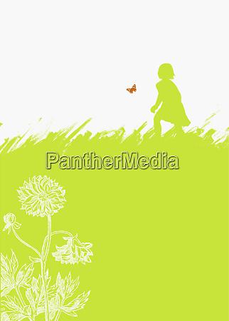 girl chasing butterfly in field