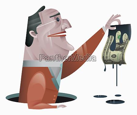 businessman holding dollar bill dripping oil