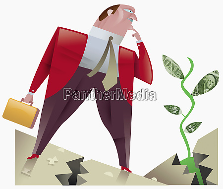 businessman looking at plant with dollar