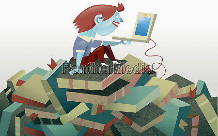boy with laptop sitting on pile